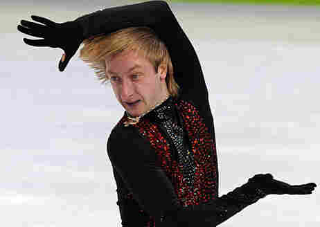 Evgeny Plushenko of Russia competes in men's figure skating during the 2010 Winter Olympic Games in
