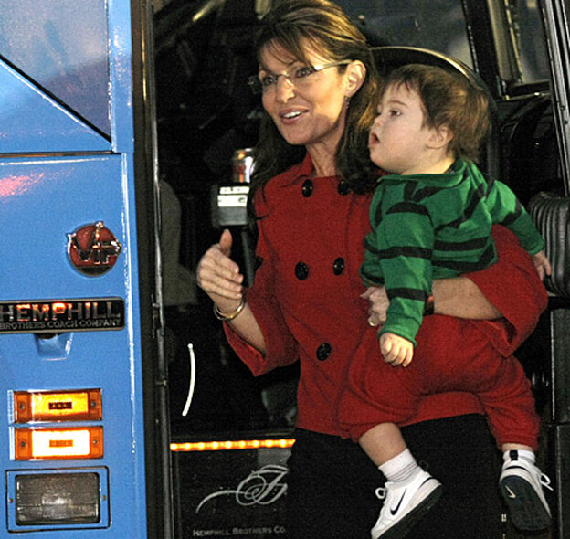 Former Republican vice presidential candidate and Alaska Governor Sarah Palin holds her son as she a