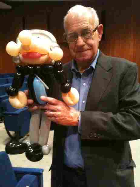 Photo of Carl Kasell with balloon likeness.