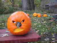 Pumpkin carved to look like Dick Cheney.