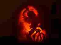 Pumpkin carved to look like Luna Lovegood.