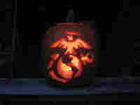 Pumpkin carved with Marines symbols.
