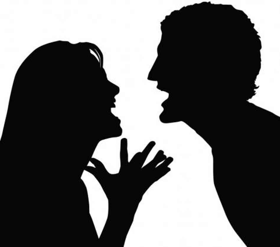Silhouette of a couple arguing.