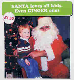 Card reads santa loves redheads, even ginger ones.