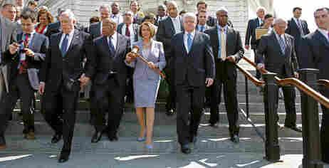 Photo of Nancy Pelosi and house members.