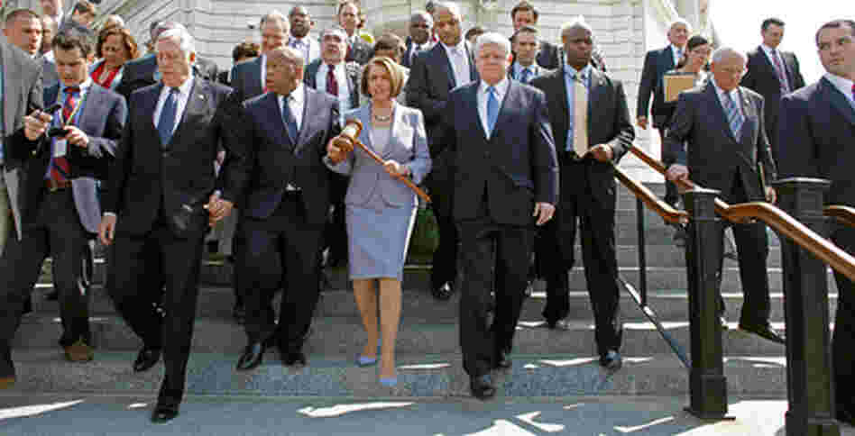 Photo of Nancy Pelosi and house members.