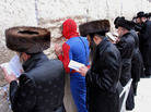 Image of man in Spiderman costume at the Wailing Wall.