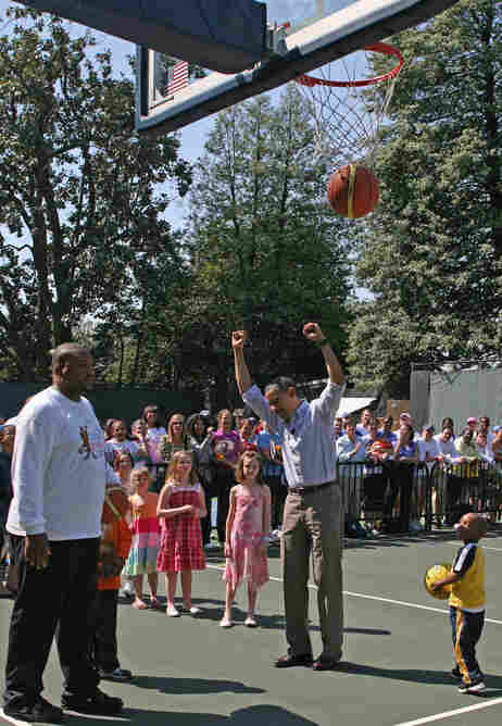 President Obama plays basketball.