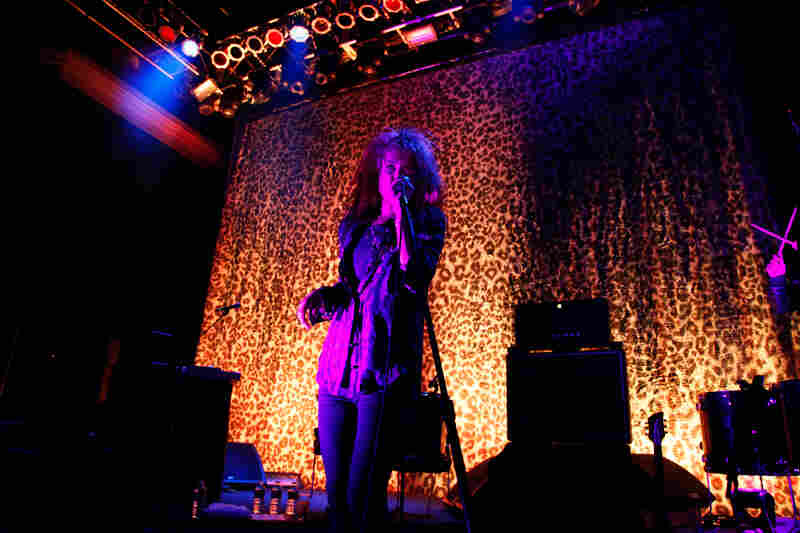 "Mosshart vamped through her sets like a rock superstar, blasting out the band's popular songs like ""Heart Is a Beating Drum"" and ""U.R.A. Fever."""
