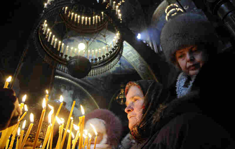 Ukrainian Orthodox Christians light candles during the Christmas liturgy in the St. Volodymyr Cathedral in Kiev.