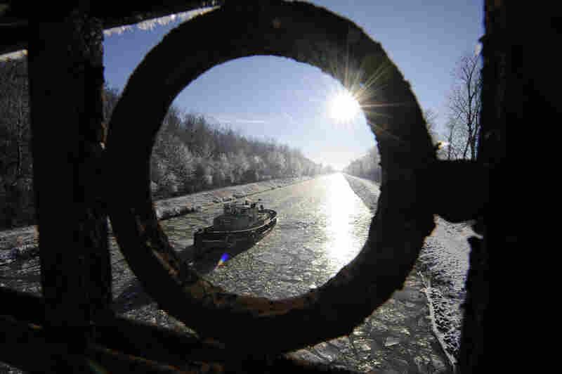 "The ice-breaker ""Wilgum"" makes its way through a frozen canal near Bolzum, northwestern Germany."