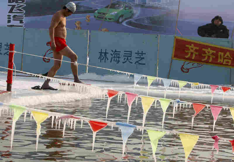 A swimmer prepares to compete during a winter swimming festival in Harbin, northeastern China's Heilongjiang province.