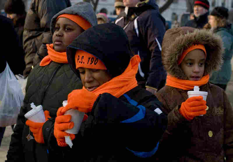 Schoolchildren drink tea to stay warm on the National Mall.