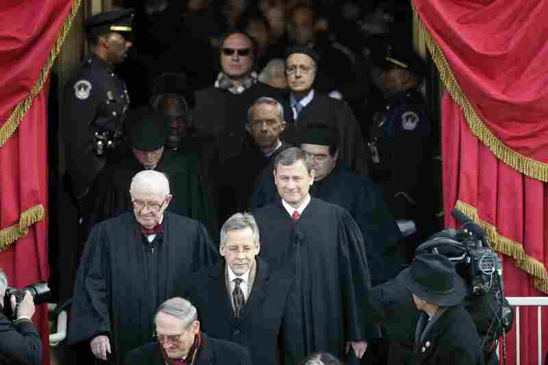 Supreme Court Justice John Paul Stevens (left) and Chief Justice John Roberts arrive at the inauguration of Barack Obama.