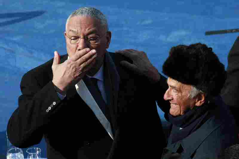 Colin Powell (left) and Elie Wiesel stand on the stage ahead of the inauguration.