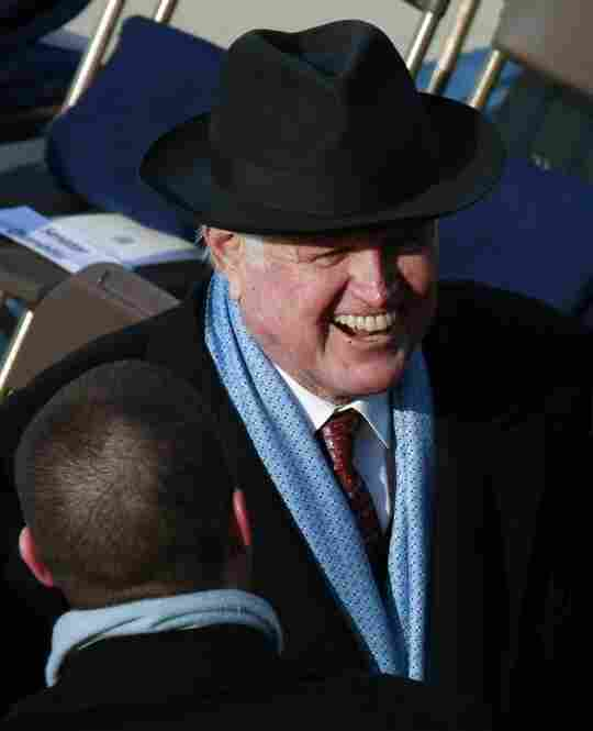 Sen. Ted Kennedy of Massachusetts laughs on the inaugural stage.