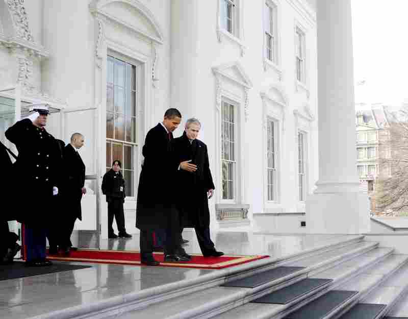 President Bush walks out with President-elect Barack Obama on the North Portico of the White House before sharing the presidential limousine en route to Capitol Hill.