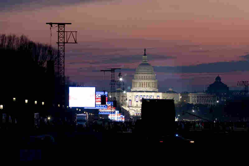 The U.S. Capitol is illuminated as dawn breaks on the day of the inauguration.