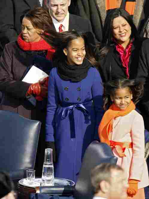 From left,, Michelle Obama's mother Marian Robinson, Obama's sister Maya Soetero-Ng, and Malia and Sasha Obama stand on the stage ahead of the inauguration.