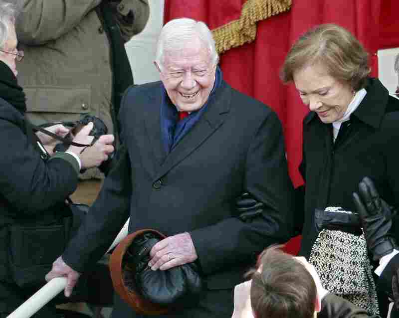 Former President Jimmy Carter and his wife, Rosalynn, arrive at the inauguration.