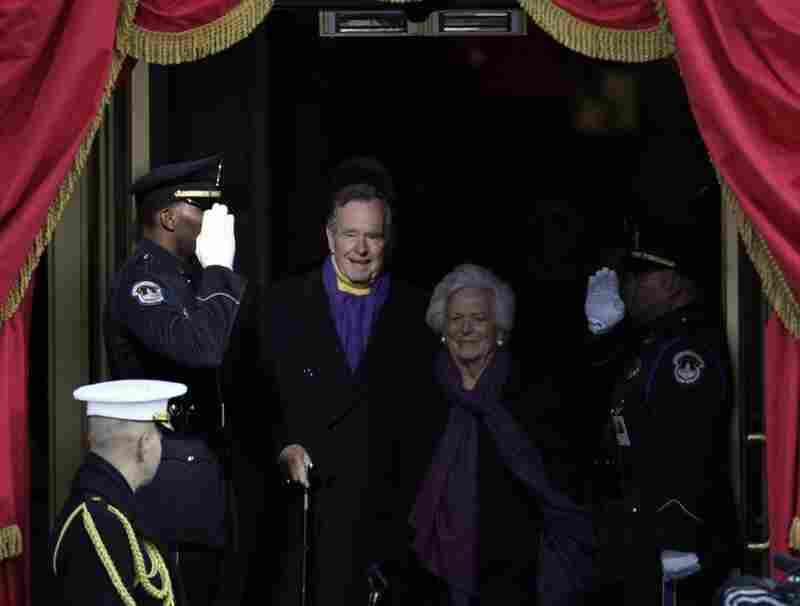 Former President George H.W. Bush and wife, Barbara, arrive on the stage.