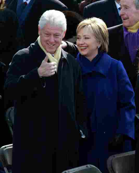 Former President Bill Clinton and Secretary of State designate Hillary Clinton arrive at their seats.