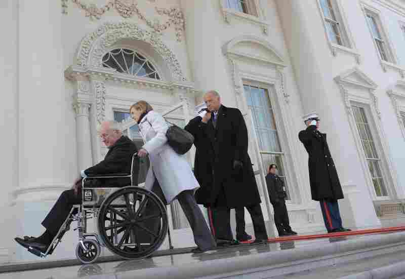 Vice President Dick Cheney leaves the White House in a wheelchair followed by his successor, Joe Biden. Cheney pulled a muscle in his back Monday while moving boxes.