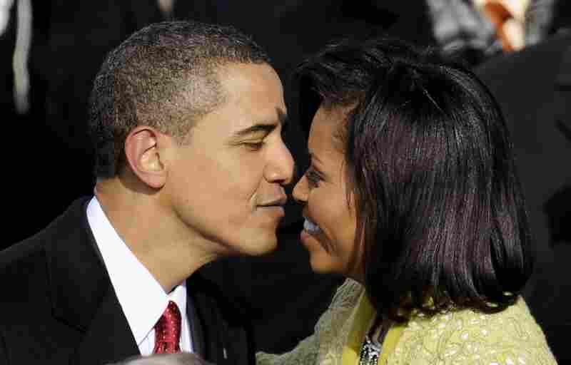 After being sworn in as president, Obama shares a kiss with his wife, Michelle.