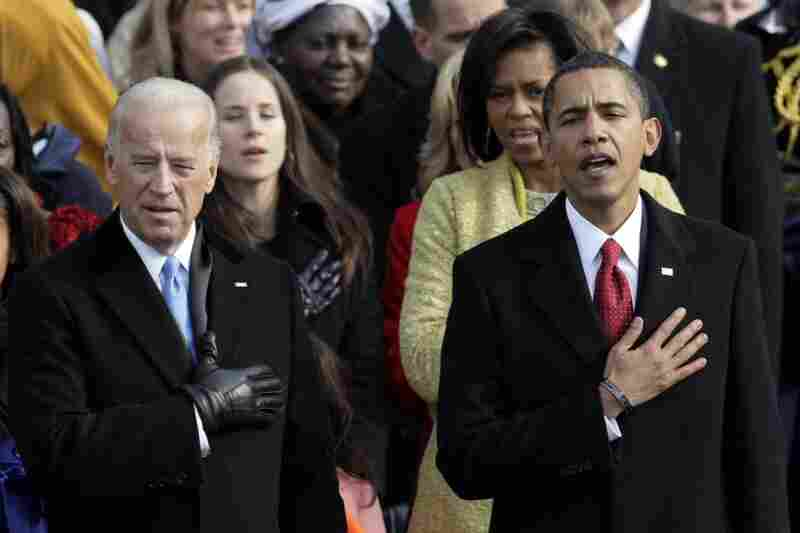 Vice President Joe Biden and President Barack Obama sing the National Anthem after taking the oath of office.