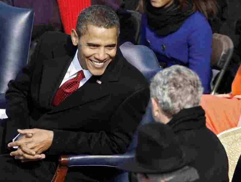 Barack Obama talks with George W. Bush during the inauguration.