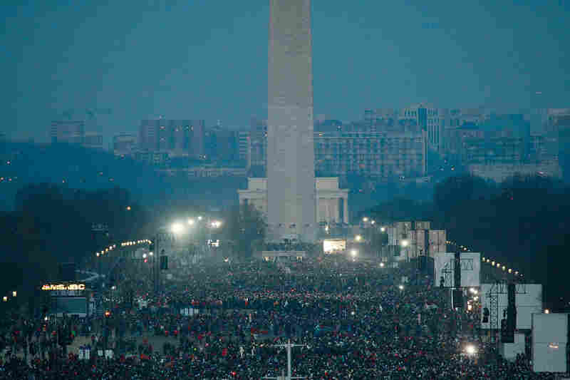 People fill the National Mall in the early morning hours before the inauguration.
