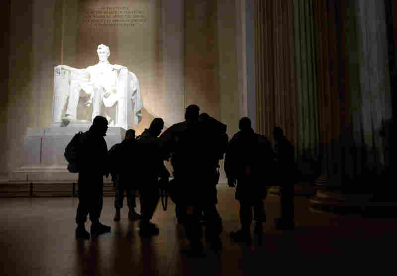 A group of soldiers based in Frederick, Md., pays a pre-dawn visit to the Lincoln Memorial.