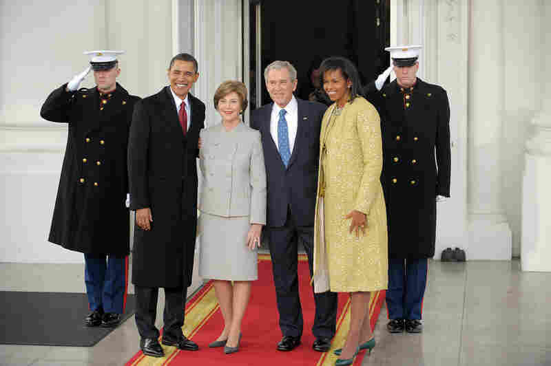 President Bush and first lady Laura Bush greet Barack and Michelle Obama on the North Portico of the White House.