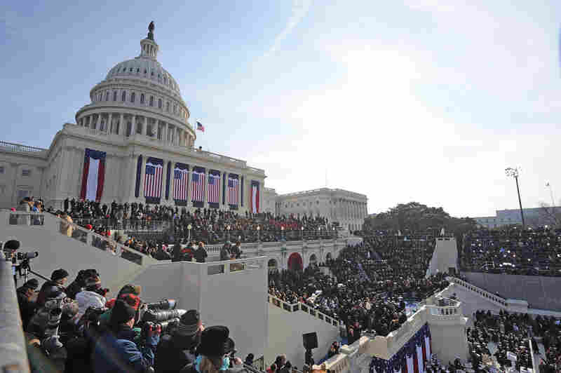 The crowd at the Capitol awaits the arrival of Barack Obama.