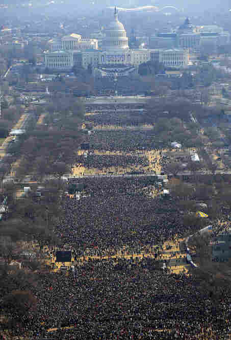 An aerial view of the Capitol and National Mall shows the crowds of people gathered in Washington on Inauguration Day.