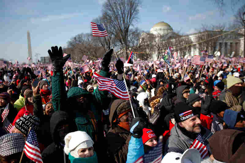People celebrate the inauguration of a new president, Barack Obama.