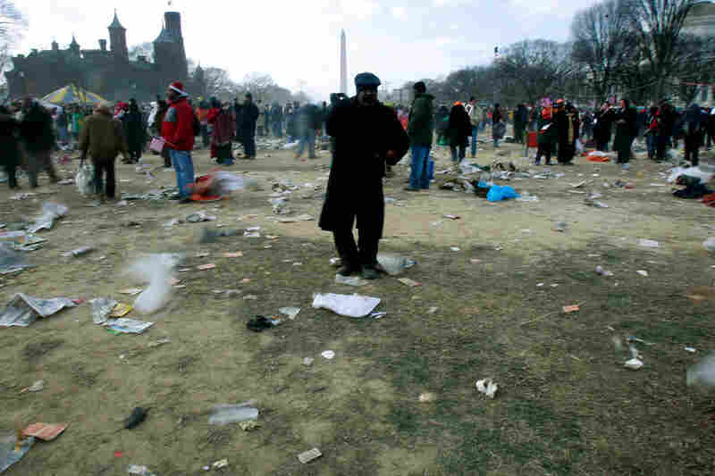 A man walks amid trash left behind by inauguration crowds.