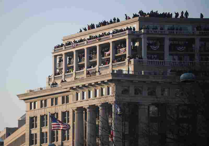 People crowd the roof of a Washington building in hopes of catching a glimpse of President Barack Obama and the rest of the inaugural parade.