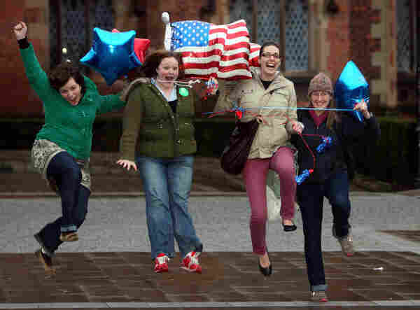 American students at Queens University in Belfast, Northern Ireland, jump up and down as Barack Obama is sworn in.