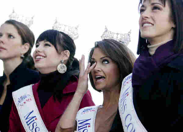 In Las Vegas, Planet Hollywood broadcast the inauguration live for visitors, including Miss America pageant contestant Jackie Geist of California (second from right).