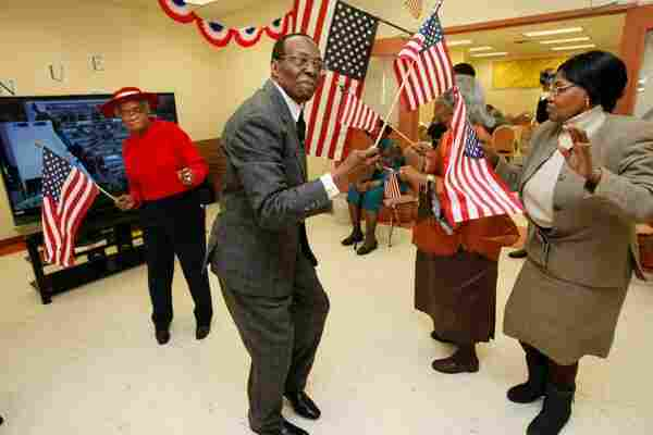 As the ceremony in winds down in Washington, D.C., the Fort Greene Senior Action Center in Brooklyn, N.Y., turns into a dance party.