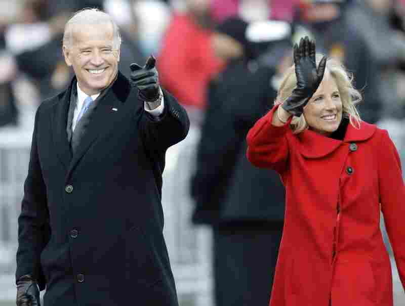 Vice President Joe Biden and his wife Jill wave to the crowd while walking part of the parade route.