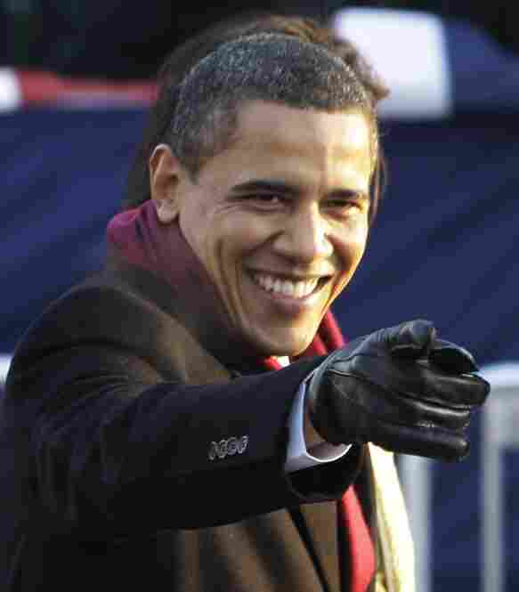President Barack Obama points to the crowd of thousands during his inaugural parade.