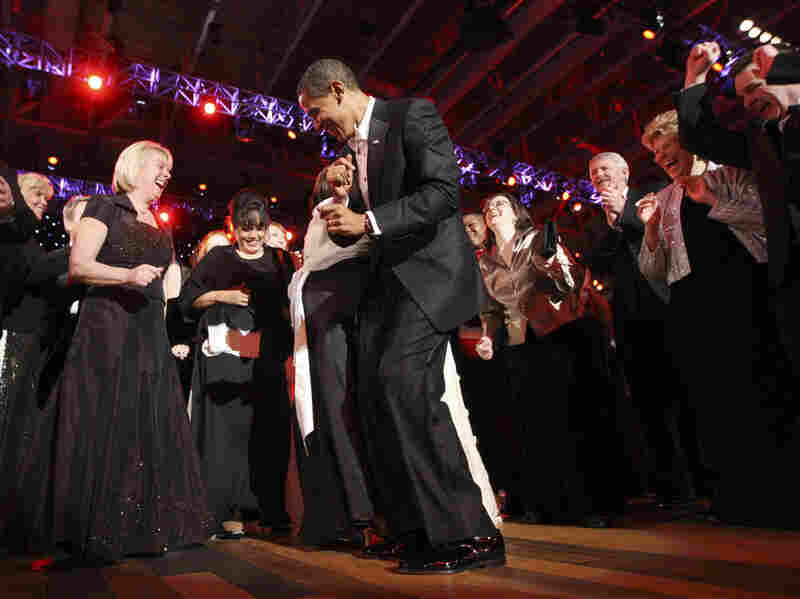 Obama gets down on the dance floor with guests at the Neighborhood ball.