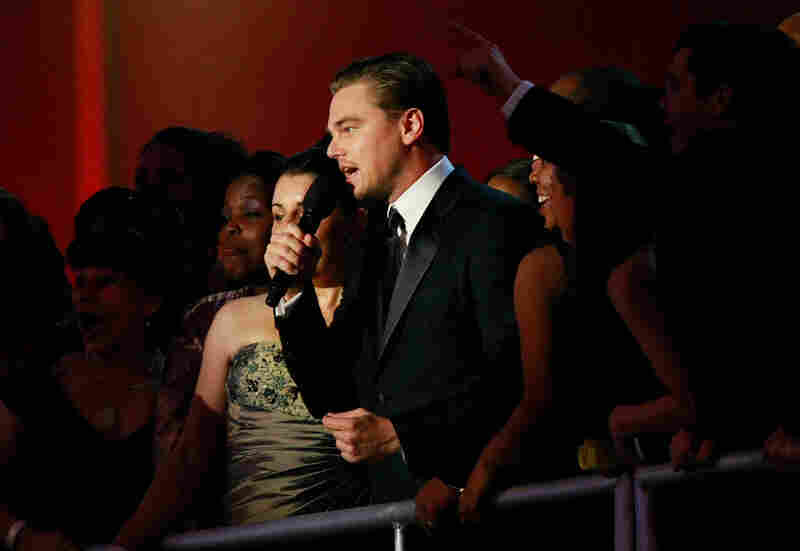 Actor Leonardo DiCaprio talks with the crowd during the Neighborhood Inaugural Ball.