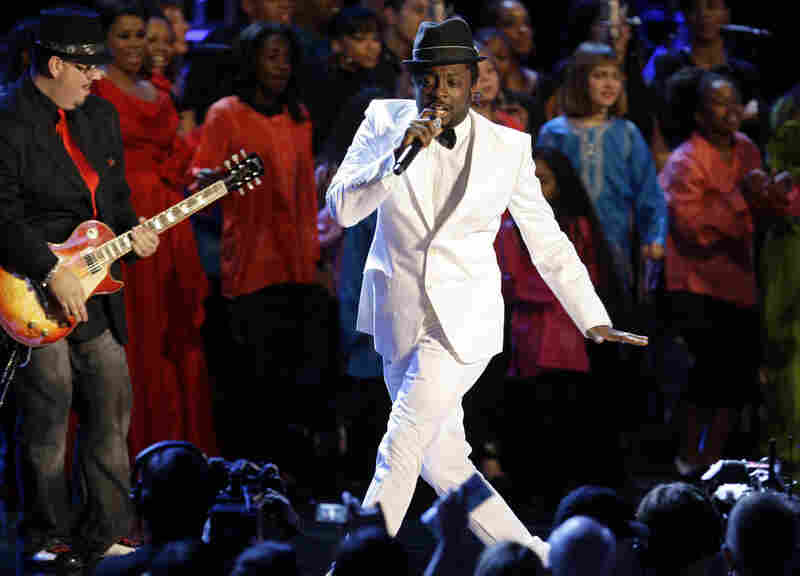 Singer will.i.am performs at the Neighborhood Ball.