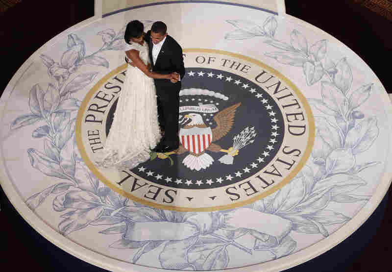 The Obamas take the spotlight at the Commander-in-Chief Inaugural Ball at the National Building Museum.
