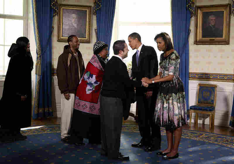 The president and first lady Michelle Obama greet members of the public in the Blue Room during an open house tour.
