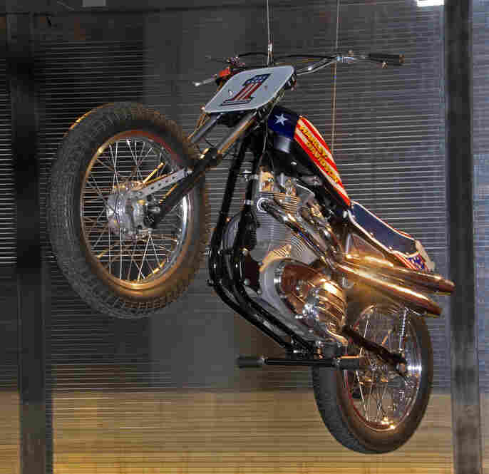 """An exhibit of """"extreme"""" Harleys includes a replica of the bike Evel Knievel crashed while trying to jump 13 buses at London's Wembley Stadium in 1975."""
