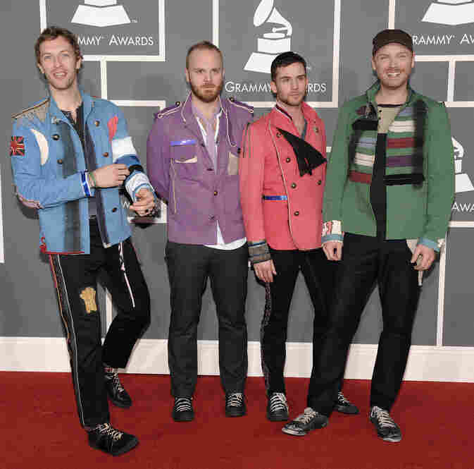 Coldplay band members sport colorful blazers, a nod to the Beatles album Sgt. Pepper's Lonely Hearts Club Band.